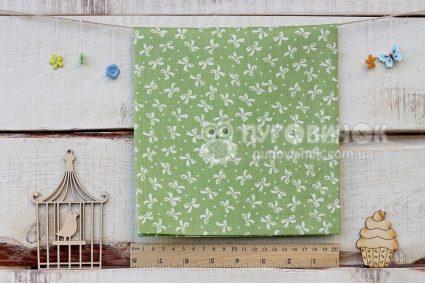 "Ткань ""Бантики белые на зеленом """