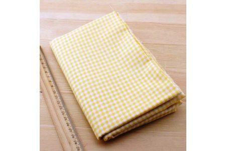 Тканина жовта асорті 50*50см клітинка біла
